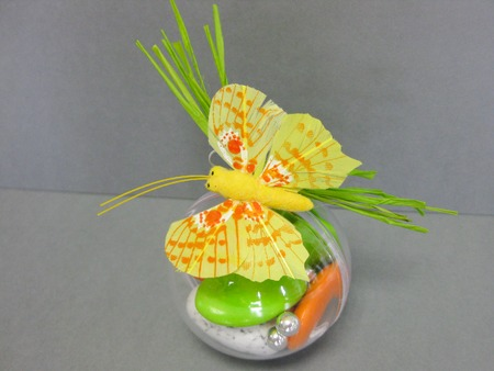 Heap of sugared almonds in a butterfly for present
