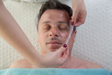pore: Top view of man having pore cleaning procedure at spa Stock Photo