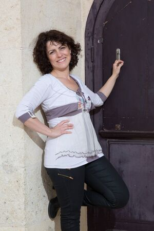 selfemployed: Portrait of happy woman posing  friendly smiling, looking at camera