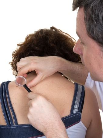 medicalcare: Dermatologist male looking at womans mole isolated