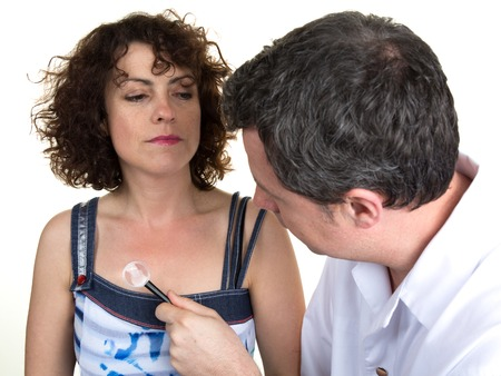 tumour: Dermatologist looking at womans mole at office