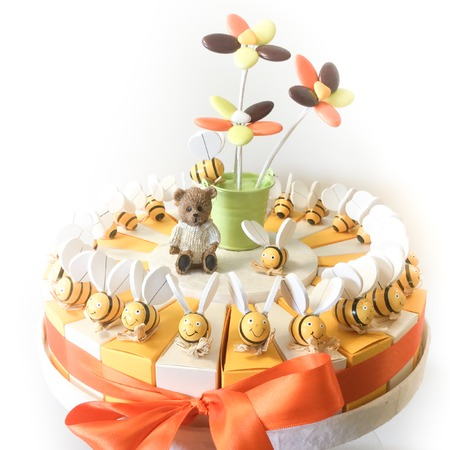 sugared almonds: Heap of sugared almonds in a cake for present Stock Photo