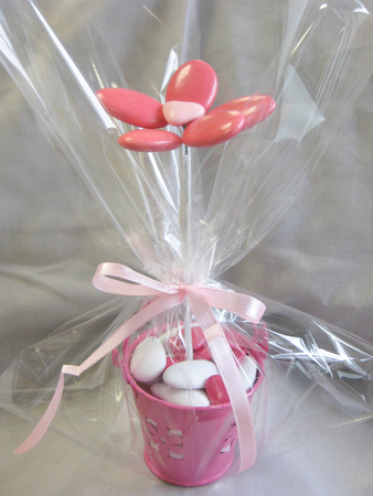 Heap of sugared almonds in a flower for present