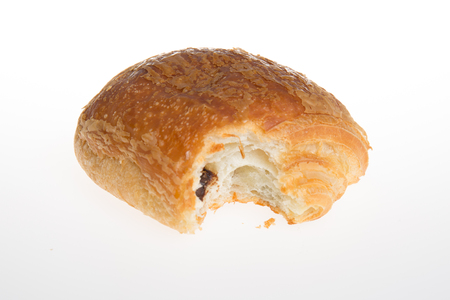 au: Studio shot of a half eaten fresh pain au chocolat
