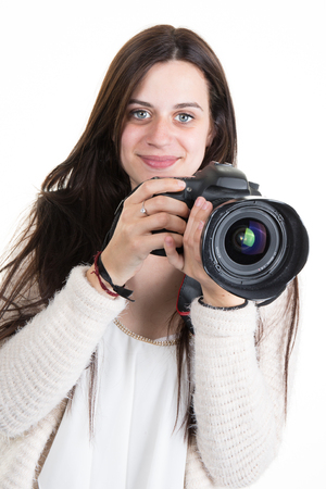 Happy and gorgeous young woman Photographer Shooting You