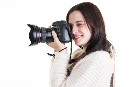 Profile view of Female Photographer Shooting someone in studio Stock Photo