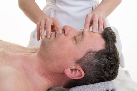 cranial: Facial and cranial osteopathy therapy in a medical room Stock Photo