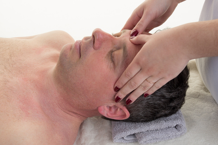 massagist: Facial and cranial osteopathy therapy by female therapist