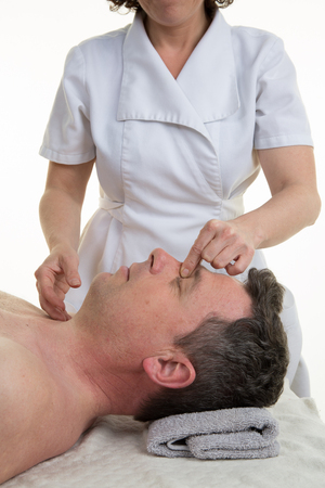 cranial: Facial and cranial osteopathy therapy given by a female