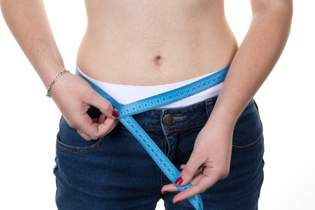 woman measuring: Woman measuring her waist after loosing weight