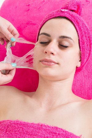 beauty center: Beauty center a Girl is removing facial peel off mask