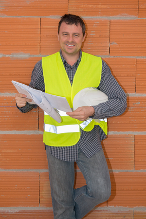 blue prints: Construction Foreman on the Job site with blue prints Stock Photo