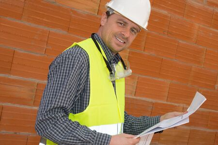 job site: Construction man on the Job site looking at the camera