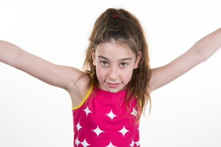arms wide open: Happy little  girl with her arms wide open, Isolated over white Stock Photo