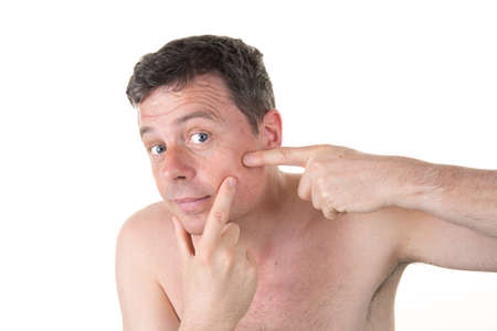 cutaneous: Handsome man touching his hair with hand and smiling