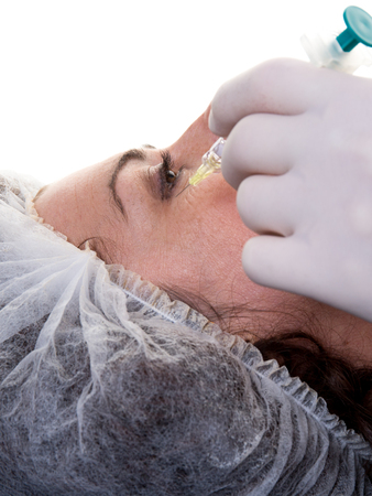 the ageing process: Woman having injection in face as beauty treatment