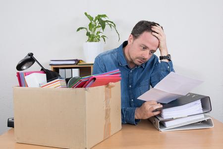 dismiss: Desperate man reading a dismiss notification, preparing his box
