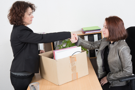 unemployed dismissed: Woman after fired shake hand of her boss Stock Photo