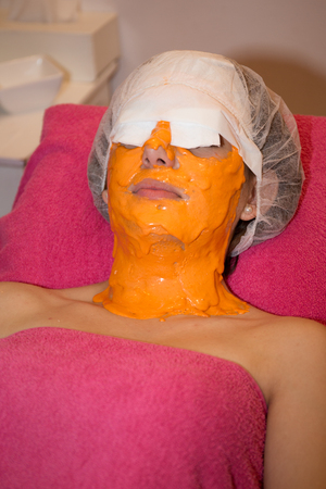 liniment: Woman resting with a Natural facial Mask Stock Photo