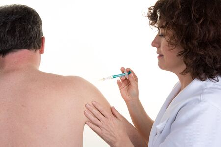 swine flue: Serious doctor gives an injection on the back of a man Stock Photo