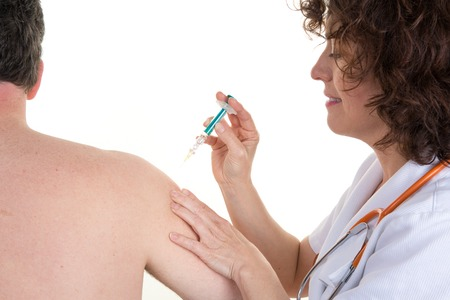 swine flue: Woman doctor gets an injection to a man