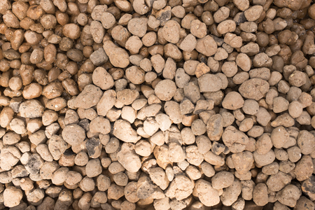 pebbles: brown river pebbles background Stock Photo
