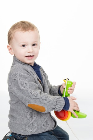 soft toys: Happy little boy playing with soft toys