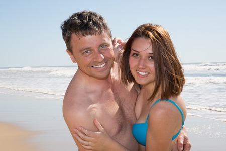 escapism: Lovely couple enjoying on the beach on a sunny day