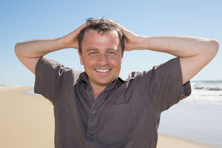 rugged man: Portrait of rugged middle aged man standing at the beach