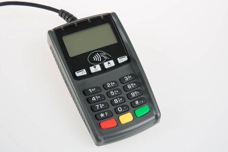 pin code: Woman hand dials pin code on pin pad of card machine