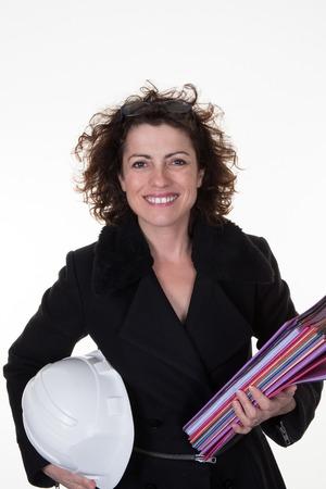 female architect: Female architect isolated on white background with stack of document