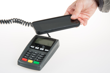 pay bill: Image of woman using NFC technology to pay bill