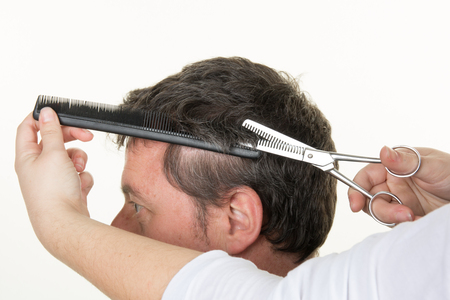 haircuts: Mens Hairdressers; barbers. Barber cuts the client machine for haircuts.