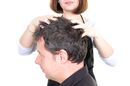 sylist: Man getting a massage while having hair cut at salon by hairdresser