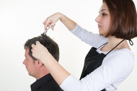 coiffeur: Mens hair cutting scissors in a beauty salon