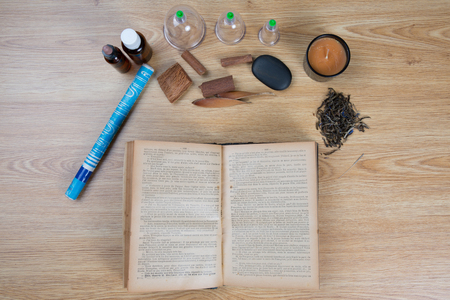eastern health treatment: Acupuncture needles, moxa sticks, macerated oil, herbs TCM Traditional Chinese Medicine concept photo