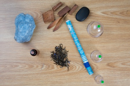 macerated: Acupuncture needles, moxa sticks, macerated oil, herbs TCM Traditional Chinese Medicine concept photo