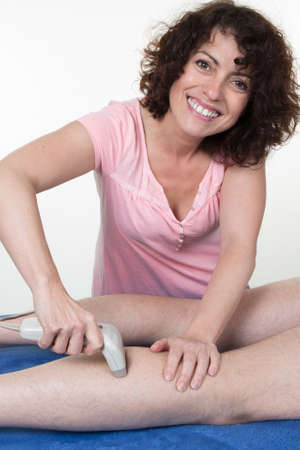 beauty center: Laser hair removal on man legs at beauty center