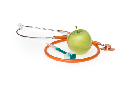un healthy: Apple organic natural nutrient apple doctors stethoscope and syringe Stock Photo