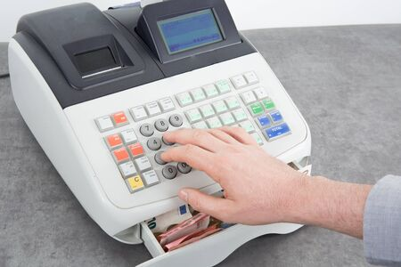 to till: Hand open the cash register and giving change in euro from the till