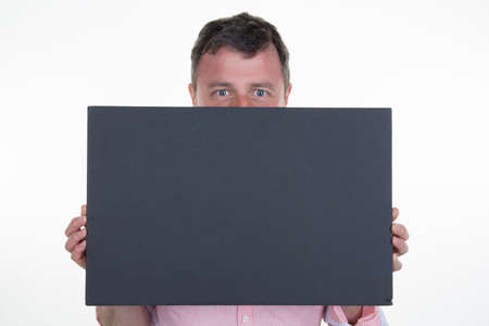 blanck: Man with a blanck black board isolated Stock Photo