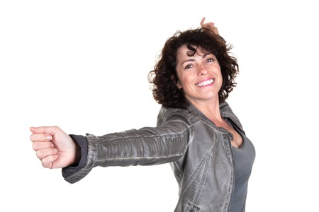 Woman with arms raised outstretched smiling joyful and ecstatic full of happiness