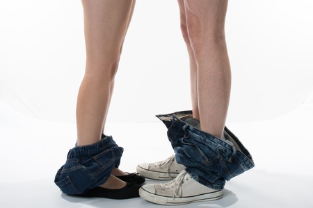 Man and woman who undresses, trousers down. Man and woman who undresses