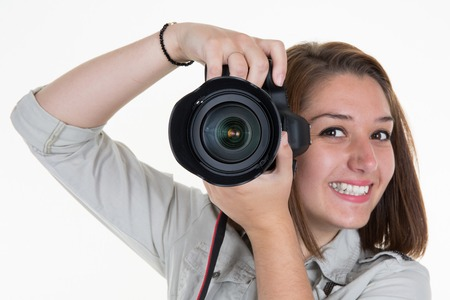 Smiling Female Photographer Shooting You isolated Stock Photo