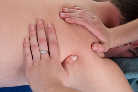 unclothed: Closeup of professional back massage at spa