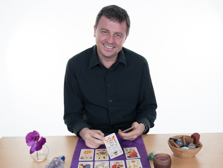 Smiling Man fortuneteller on a whitebackground