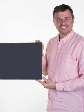 blanck: Man in pink with a blanck black board isolated Stock Photo