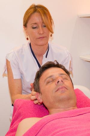 beauty center: Man getting a face massage in a beauty center