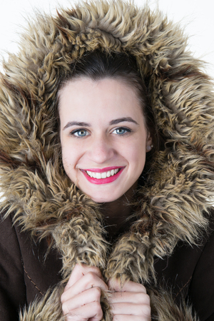 gingerish: Portrait of attractive young woman wearing warm fur coat in winter.