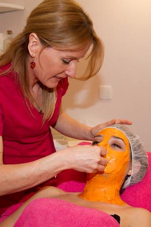 orange peel skin: Portrait of girl young woman in orange facial peel off mask Beauty and body skin care. Studio shot. Stock Photo